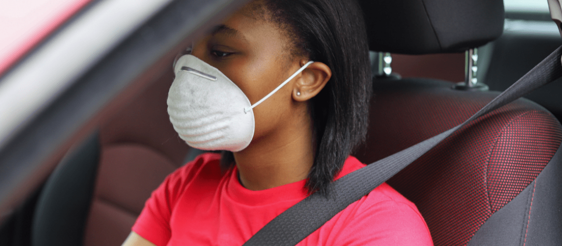 Teen driver wearing a mask to protect herself from Covid-19